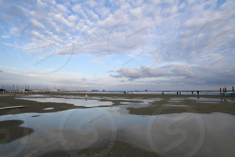 Tiny people sea Cyprus water bug place Sky reflection  photo