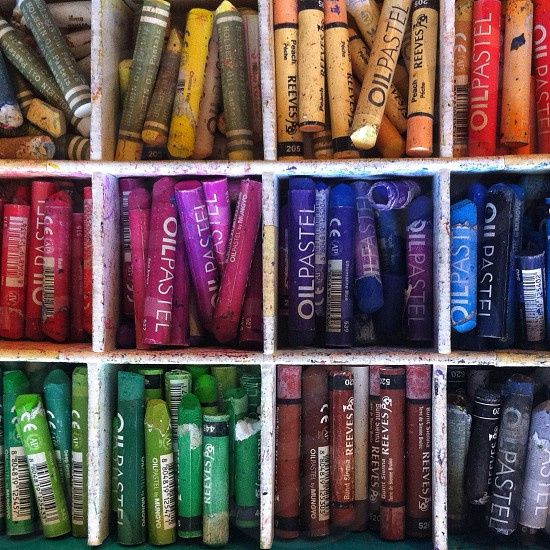 piled crayons on shelves photo