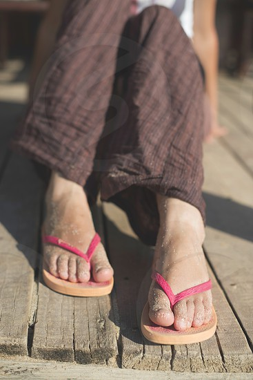Foot in thongs on the beach photo