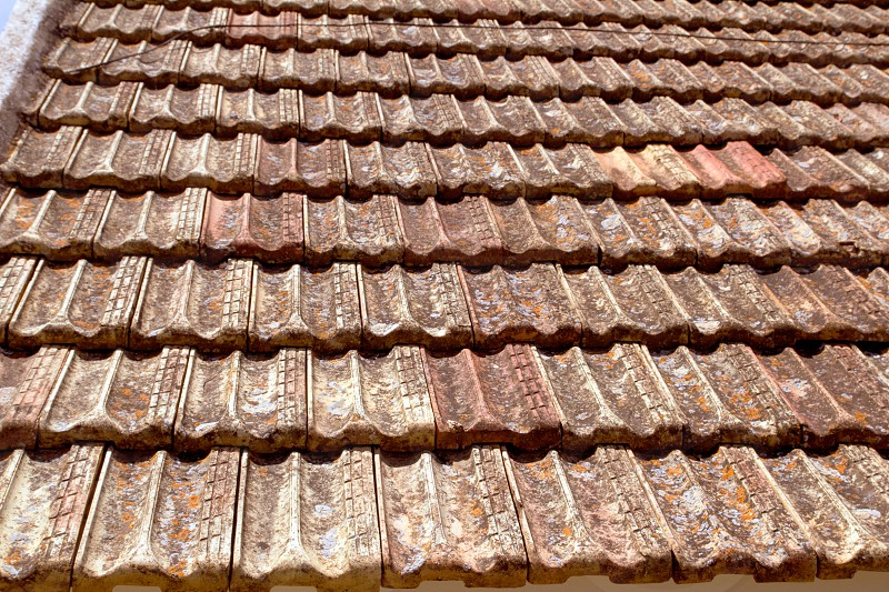 Clay flat roof tiles weathered in Ibiza Spain photo