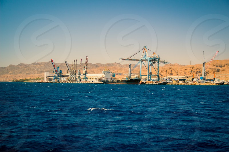 Port of Eilat Israel.A cargo ship docked in the port. photo