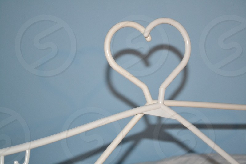 white cloth hanger forming heart shape photo