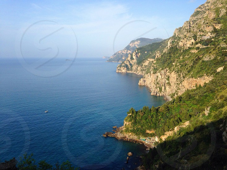 panoramic view of the brown cliffs near the sea photo