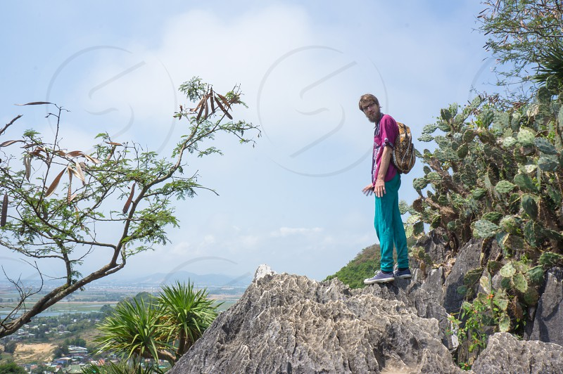 Balancing on the rocks of Marble mountains Vietnam. photo