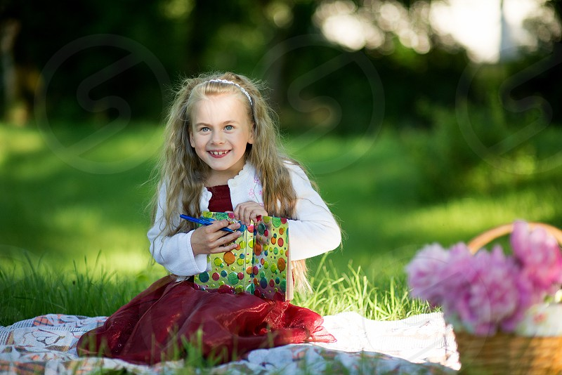 Portrait of little beautiful girl with pen and book photo
