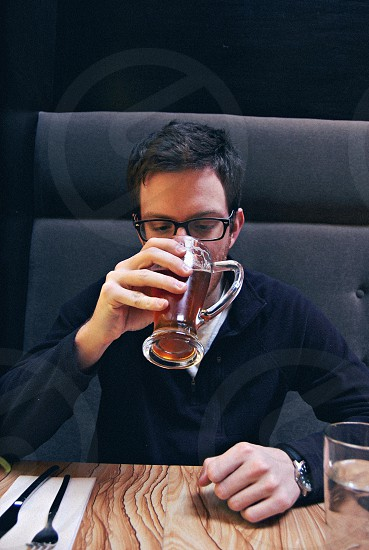 Man enjoying a beer photo