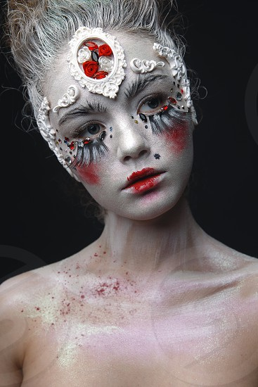 Portrait of a beauty young girl with white hair and original creative makeup. photo