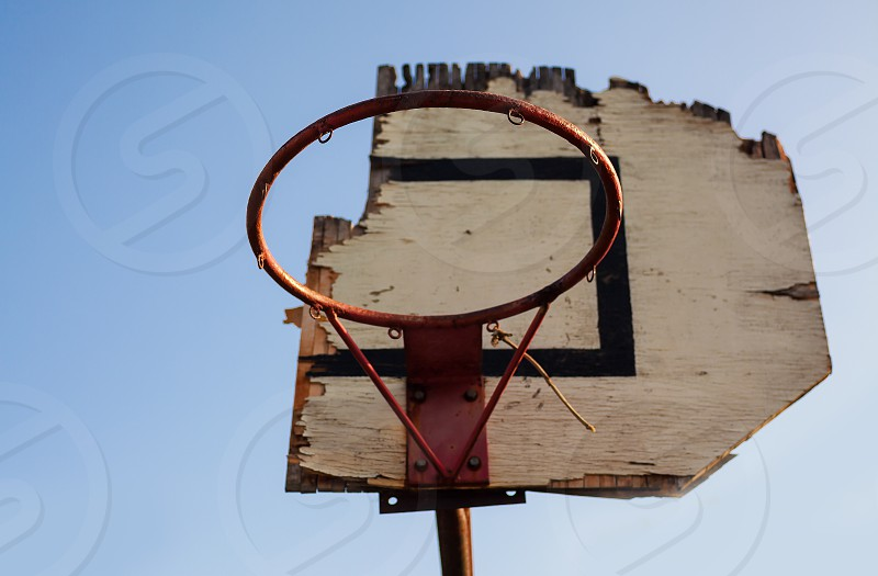 View on an old damaged basketball hoop. photo