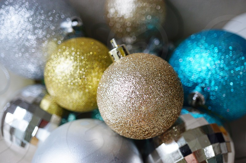 Round Christmas holiday ornaments with sparkles and glitter photo