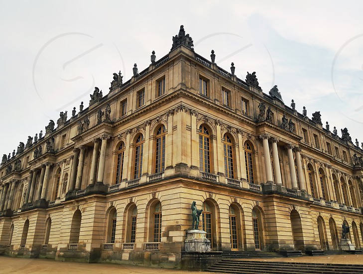Outdoors Versailles Palace facade view from the corner. Royal chateau world heritage site. photo