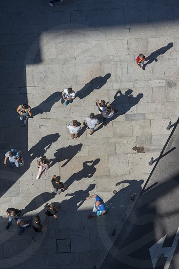 shadow of people in the city centre of Porto in Porugal in Europe. photo
