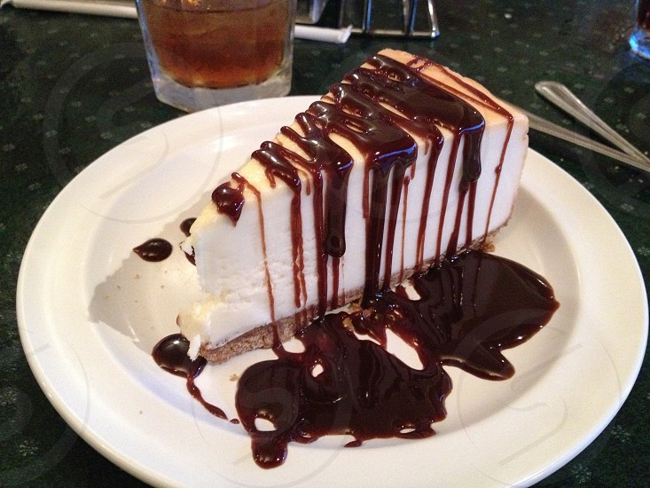 Cheesecake covered in chocolate sauce photo