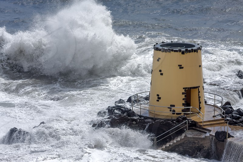 Tropical storm hitting the lookout tower in the grounds of the Savoy Hotel Funchal Madeira photo