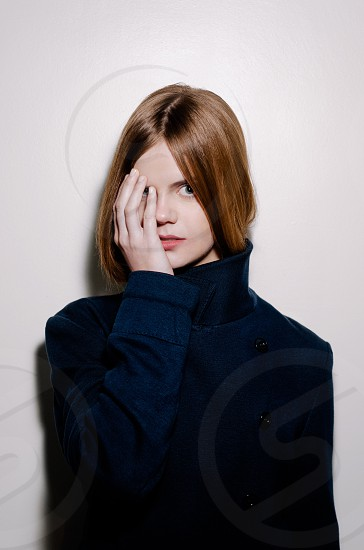 girl in blue stand collared coat photo