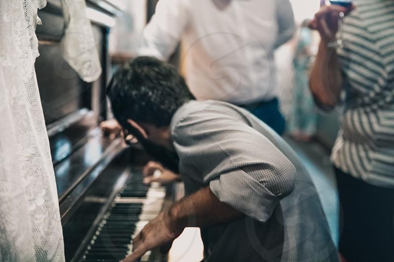 Playing a piano photo