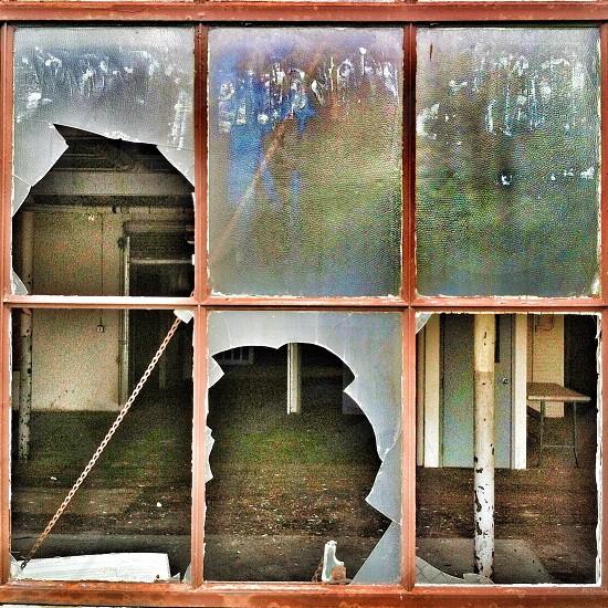 A look through a broken window photo