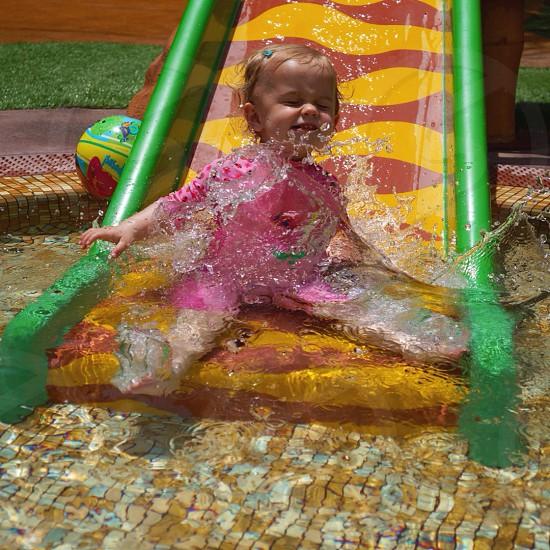 Girl slide water action splash swimming photo