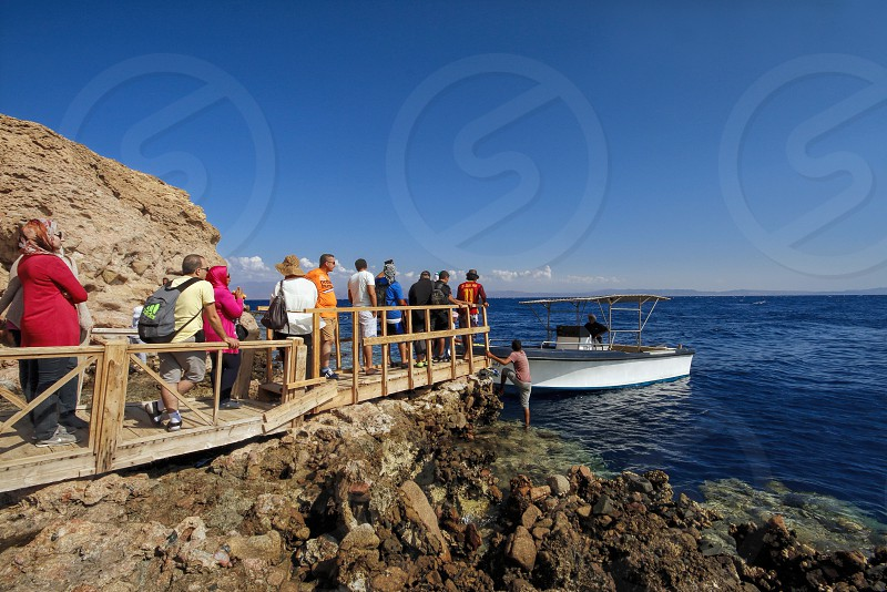Taking a ship from Dahab to Abu Galoum in Sinai Egypt photo