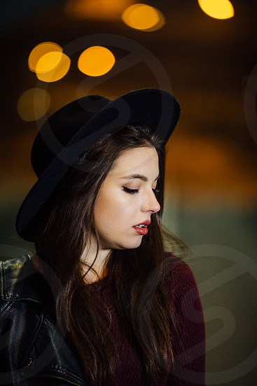 Pretty girl standing at night background alone photo