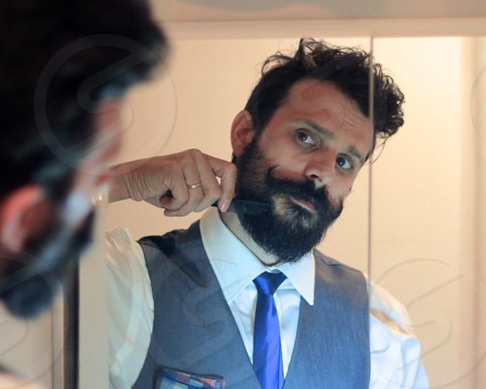 man shaving his beard photo