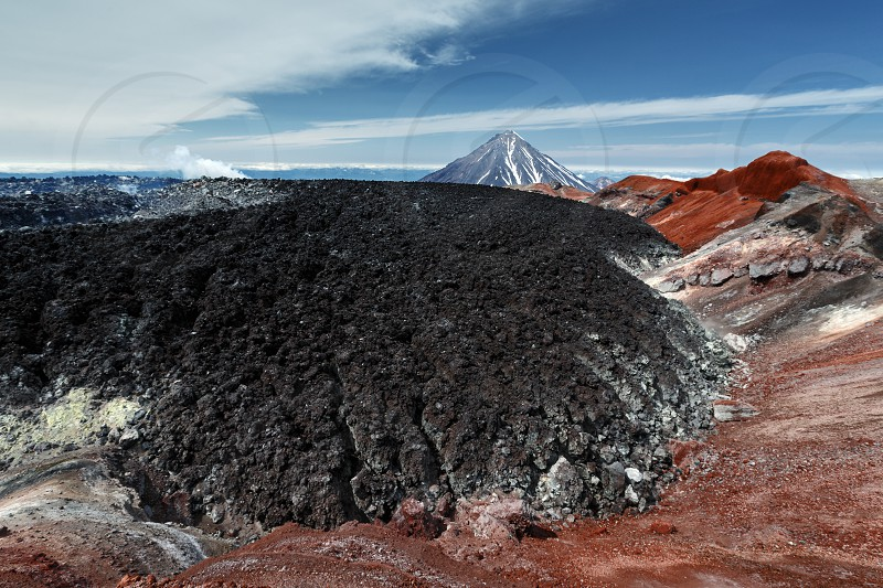 Scenery volcanic landscape of Kamchatka Peninsula - frozen lava field in summit colorful crater of active Avacha Volcano filled by eruption 1991 lava flow is located inside of Somma. Russian Far East photo