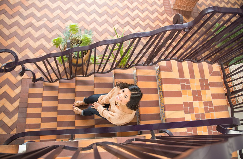 woman sitting on staircase photo