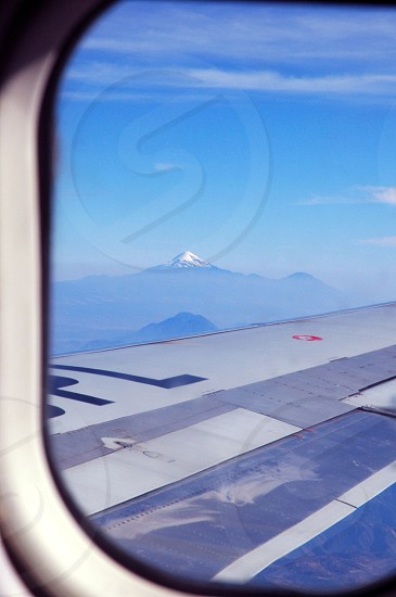 white and silver airplane wing under blue sky photo