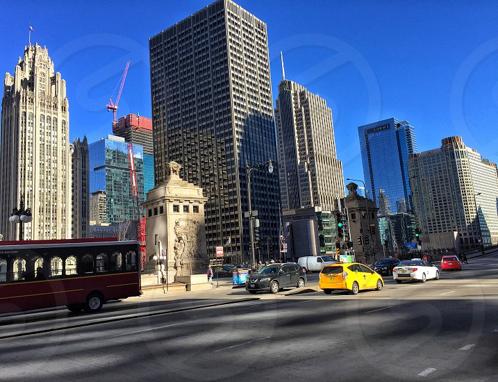 City street horizontal cars buildings cab trolleyblue sky construction activity photo