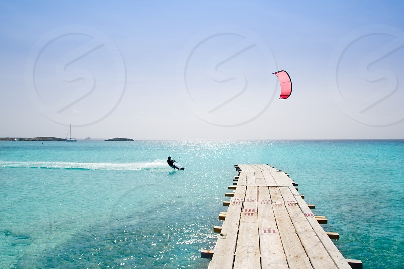 Formentera beach wood pier over turquoise water from balearic Mediterranean sea paradise photo