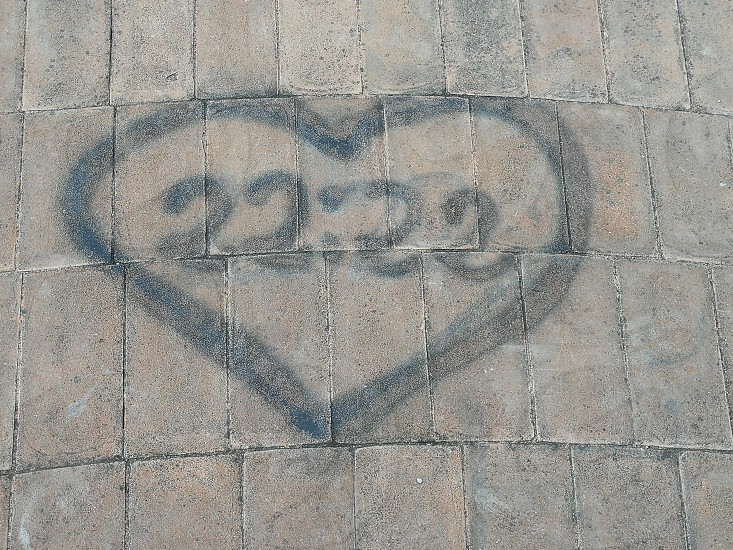 heart illustration on gray pavement photo