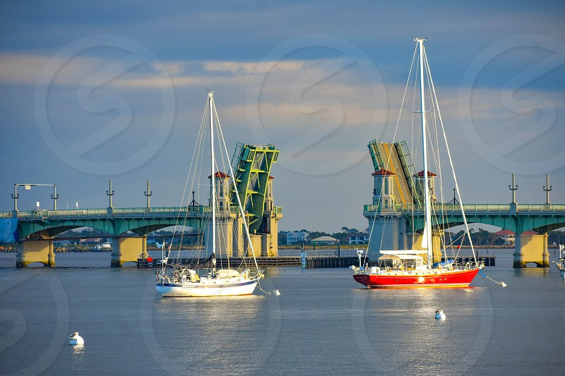 St. Augustine Florida. January 26  2019 .Sailboats and Bridge of Lions on cloudy sky background in Florida's Historic Coast . photo