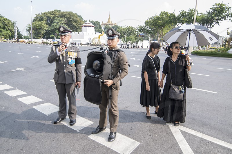 Thai Police on a road at the Funeral Days of Rama 9 in the city of Bangkok in Thailand.  Thailand Bangkok November 2017 photo