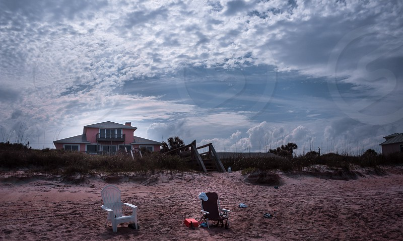Beach house Jacksonville Florida filter sand  clouds beautiful sky. photo