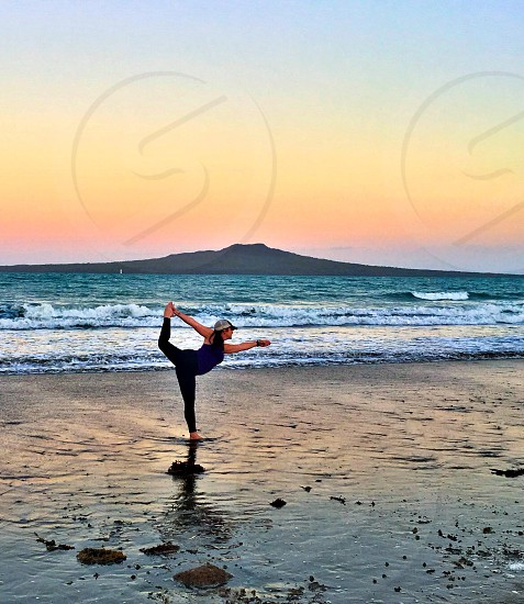 Yoga. Rangitoto Volcano Takapuna Auckland New Zealand  photo