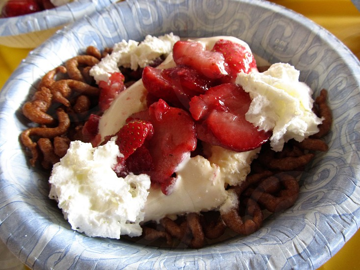 Chocolate funnel cake sundae with strawberries fair food photo