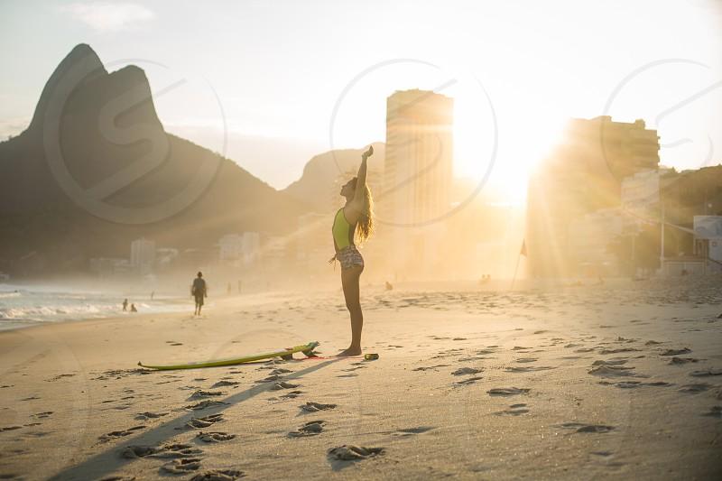 A Surfer on Leblon Beach Rio de Janeiro Brazil. photo