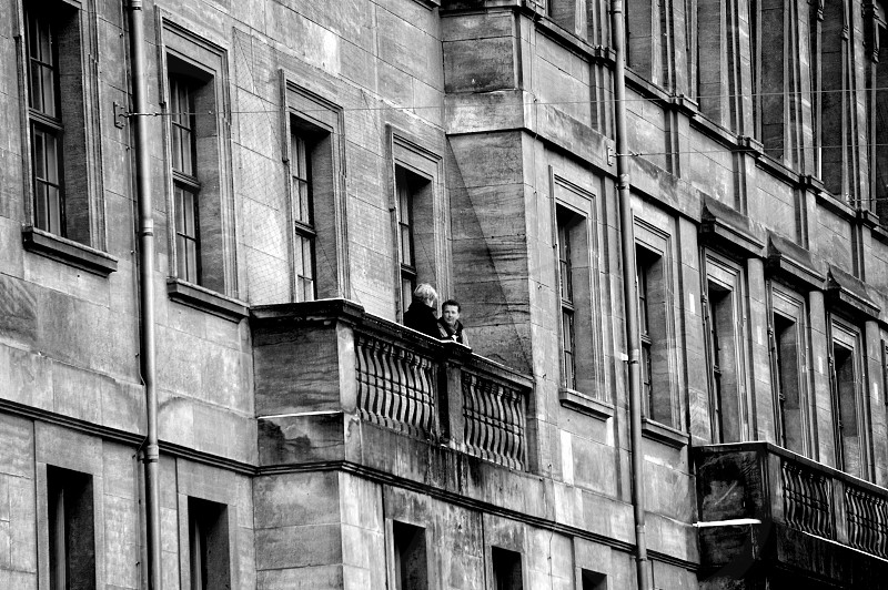 2 person on building terrace photo