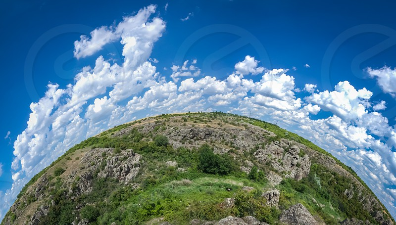 Panoramic view of deep granite Aktovo canyon with river and cloudy sky One of the natural wonders of Ukraine. photo