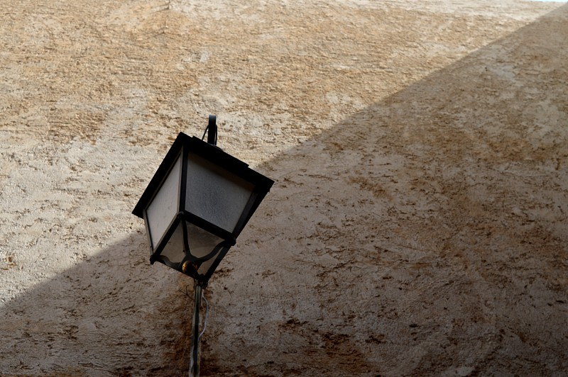 A lonely street lamp on the wall. photo