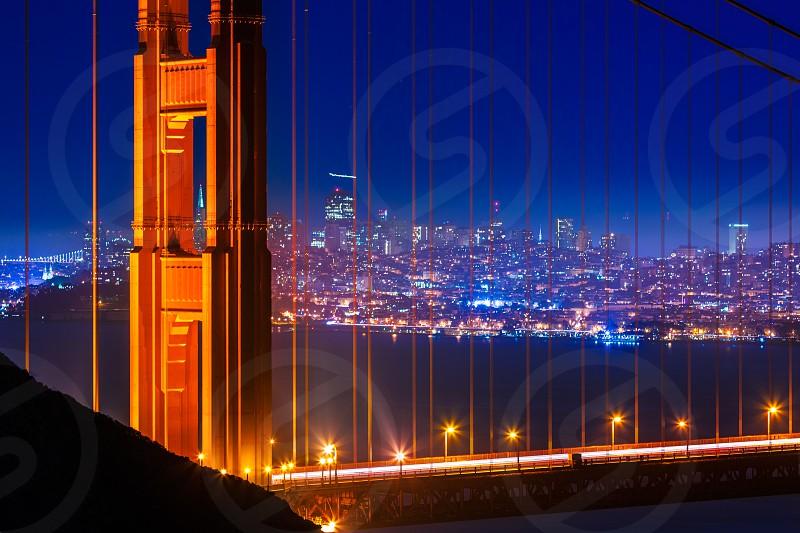 Golden Gate Bridge San Francisco sunset view through cables in California USA photo