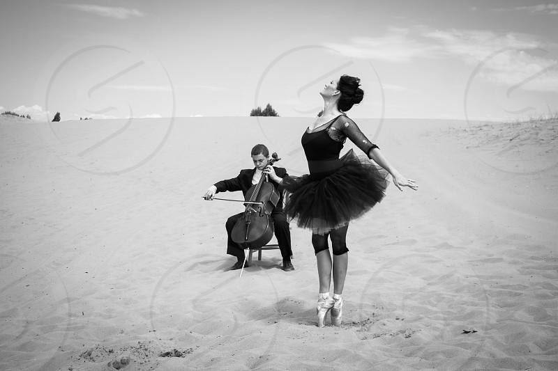 ballet dancer and musician in the desert  photo