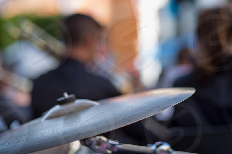 man through a cymbals photo