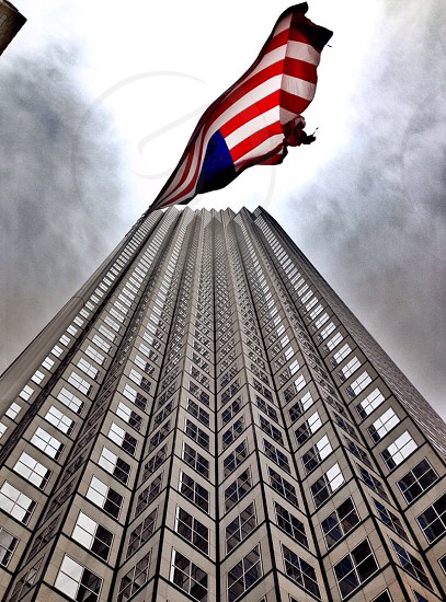 low angle high rise building with united states flag photo