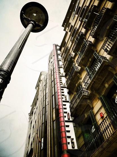 Barcelona Spain Catalonia thermometer city lamp building wall photo