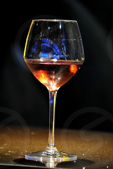 clear wine glass on black surface photo
