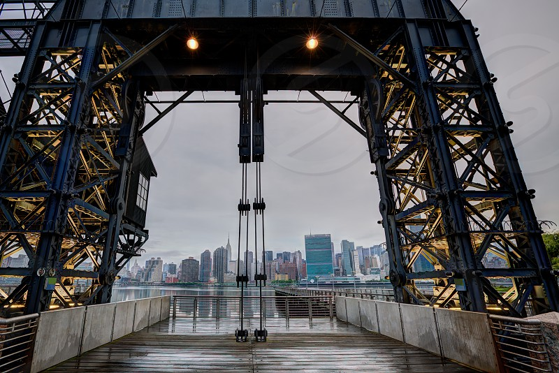 Manhattan New York cloudy skyline from East River floodgates structure USA photo