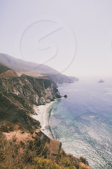 brown cliff on seashore photo