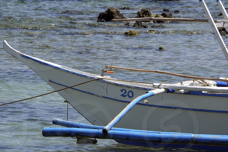 white boat with blue trim photo