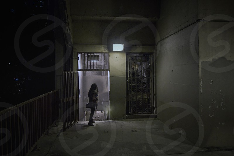 girl standing near a door with lights photo