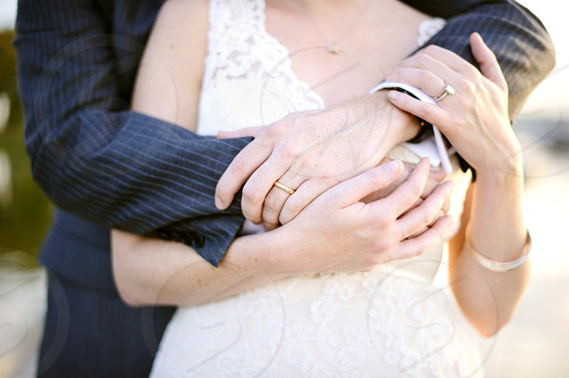 bride and groom hands and wedding rings  photo